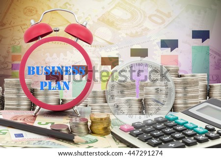 Written word business plan on a clock with compass ,coins and Calculator on money banknotes Euro and Dollars,concept of business planning and finance and savings - stock photo