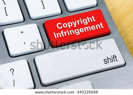 Written word Copyright Infringement on red keyboard button. Online Protection and Internet Security Concept. - stock photo