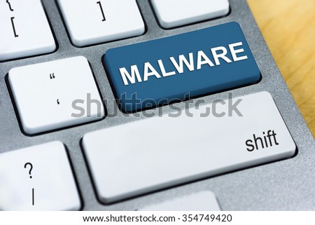 Written word Malware on red keyboard button. Online Protection and Internet Security Concept. - stock photo