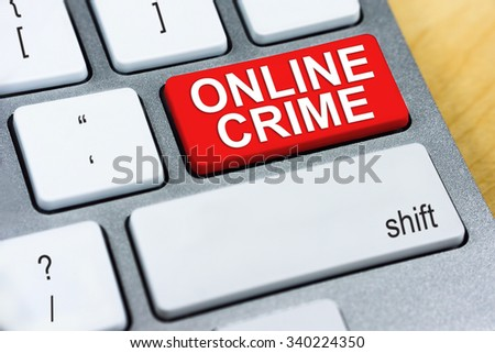 Written word Online Crime on red keyboard button. Online Protection and Internet Security Concept.