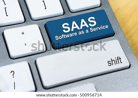Written word SAAS Software as a Service on blue keyboard button. Internet Protocol Concept