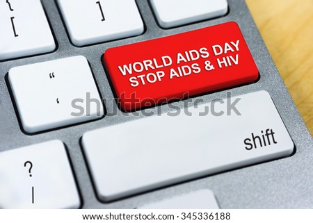 Written word World Aids Day Stop Aids & HIV on red keyboard button. Aids Awareness Concept.