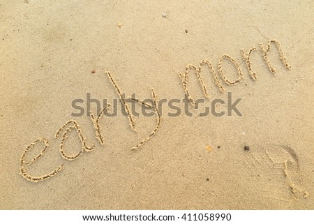 """written words """"early mom"""" on sand of beach - stock photo"""