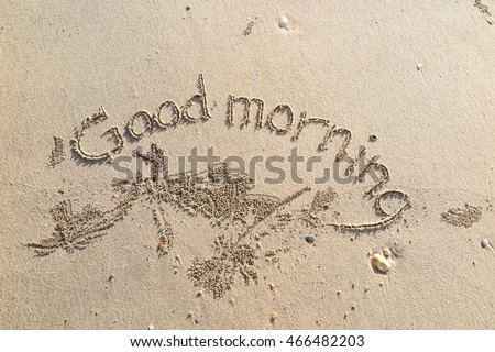 "written words ""Good morning"" on sand of beach"