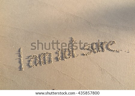 "written words ""I am not sure"" on sand of beach"