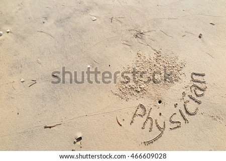 "written words ""Physician"" around hole crab on sand of beach"