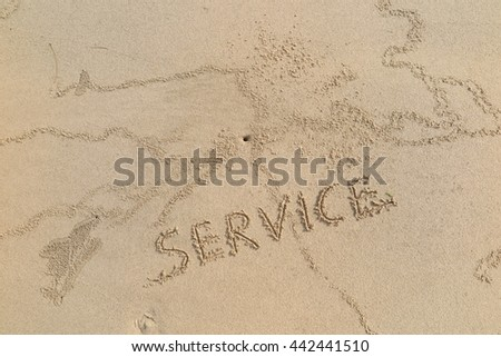 "written words ""SERVICE"" on sand of beach"