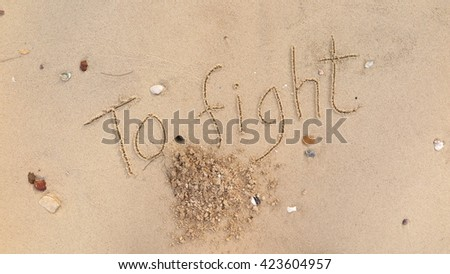 "written words ""To fight"" on sand of beach"