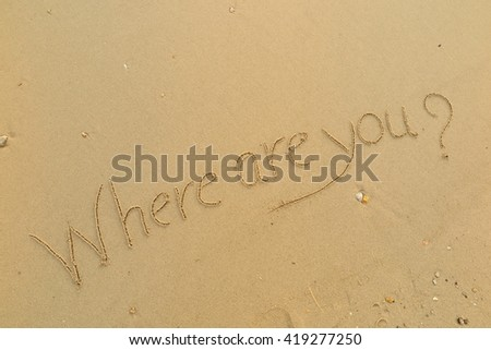 "written words ""Where are you"" on sand of beach"