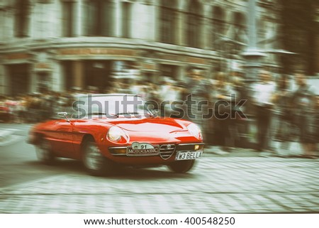 Wroclaw- August 18: Alfa Romeo on Motoclassic show on vintage effect, motion blur  in Wroclaw, Poland on August 18, 2014. - stock photo