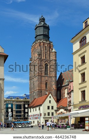 Wroclaw, Lower Silesia, Poland - June 16, 2016: View from the Market Square in the historical Old Town of Wroclaw on the St. Elizabeth's Church - Poland.