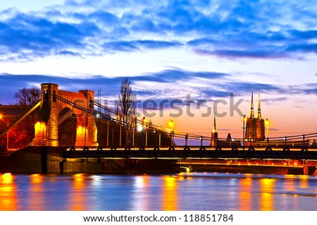 Wroclaw most famous buildings at dusk - Grunwaldzki Bridge and Cathedral in the background - stock photo