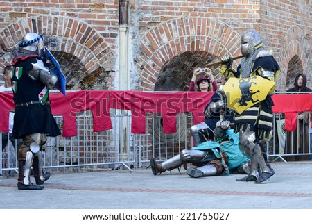 "WROCLAW - OCTOBER 5: Enthusiasts of the old knights show their costumes and skills in a duel at the Cultural Center ""Castle"" - Lesnica on 5 October 2014 in Wroclaw, Poland."