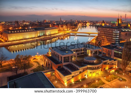 WROCLAW, POLAND - APRIL 02, 2016: Aerial view of Wroclaw. Illuminated city skyline during a beautiful sunset, April 02, 2016 in Wroclaw, Poland. - stock photo