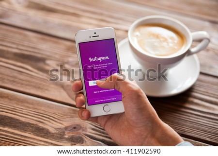 WROCLAW, POLAND - APRIL 12, 2016: Apple iPhone SE smartphone with Instagram app on screen - stock photo