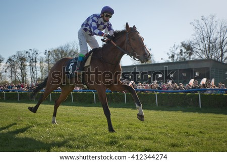 WROCLAW, POLAND - APRIL 24; 2016: International race for 3-year-old horses Group III at Racecourse WTWK Partynice. In action J. Kolakowski on a horse Lope. - stock photo