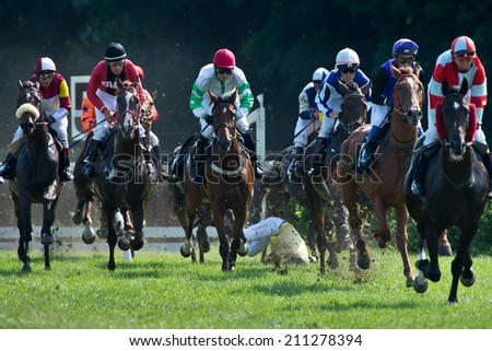 WROCLAW, POLAND - AUGUST 10; 2014: Race with fences for three year old horses a Racecourse WTWK Partynice. - stock photo