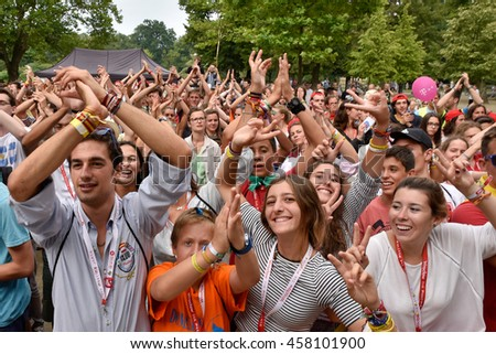 WROCLAW, POLAND - JULY 24, 2016: Playing pilgrims of the World Youth Day during open concert Mercy Fest. The concert is part of the Days in the Dioceses of World Youth Day.