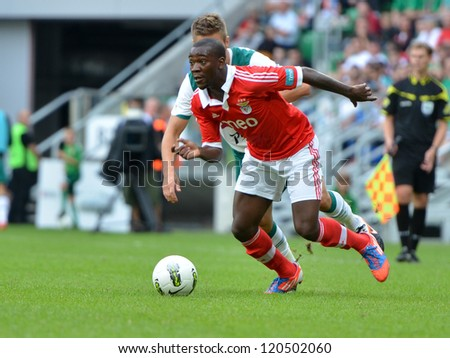 WROCLAW, POLAND - JULY 21: Semifinal Polish Masters tournament   between Slask Wroclaw and Benfica Lisbon 2:4, Ola John in action on July 21, 2012 in Wroclaw, Poland. - stock photo