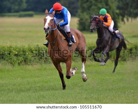 WROCLAW, POLAND - JUNE 17: Malgorzata Kryszylowicz on a horse Akfos finish in a Racecourse Partynice on June 17,2012 in Wroclaw, Poland. - stock photo