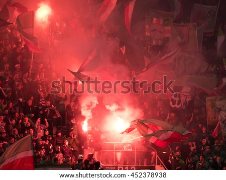 WROCLAW, POLAND - MARCH 5, 2016: Fans of Slask Wroclaw burns flares during match Polish Premer League between Slask Wroclaw - KGHM Zaglebie Lubin 0:2. - stock photo