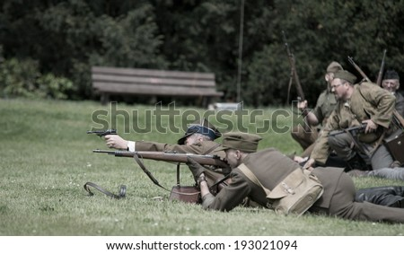 Wroclaw, Poland May 11.Polish soldier fighting till the end during historical reenactment of WWII, May 11, 2014 Wroclaw, Poland - stock photo