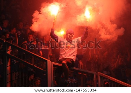 WROCLAW, POLAND - May 06: ultra supporters burn flares during match, Slask Wroclaw vs Lech Poznan on May 06, 2013 in Wroclaw, Poland. - stock photo