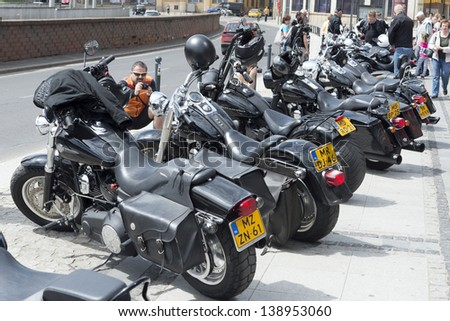 """WROCLAW, POLAND - MAY 18: View of Harley Davidson motorcycle parked in the city during """"Harley-Davidson Super Rally 2013"""" on May 18, 2013 in Wroclaw, Poland. Europe's largest 5 day motorcycle event - stock photo"""