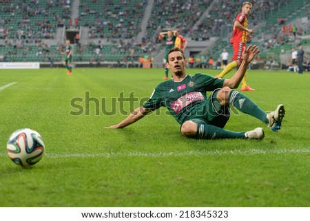 Wroclaw. POLAND - September 20: Match T-Mobile Ekstraklasa between Wks Slask Wroclaw and Korona Kielce. Dudu on slide tacklel on  September 20, 2014 in Wroclaw. Poland.