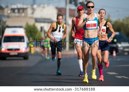WROCLAW, POLAND - SEPTEMBER 13, 2015: Runners during 33. PKO Wroclaw Marathon. - stock photo
