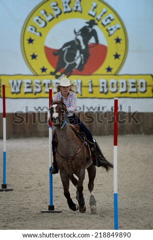 WROCLAW, POLAND - SEPTEMBER 21; 2014:  Unidentified rider during  Polish Championship in Western rides in a Racecourse WTWK Partynice. - stock photo