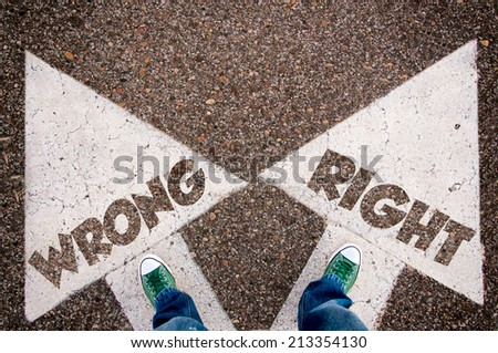 Wrong and right dilemma concept with man legs from above standing on signs - stock photo