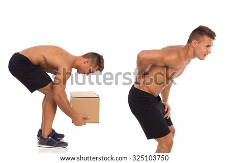 Wrong way of picking up weight. Backache. - stock photo