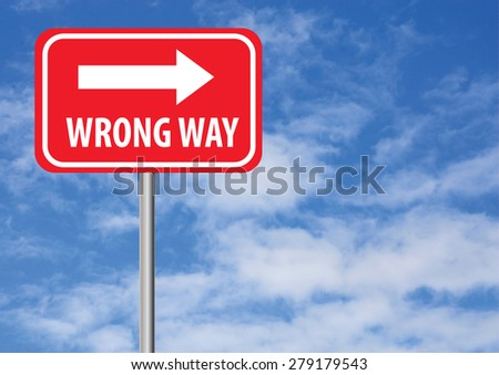 wrong way sign with arrow and sky background