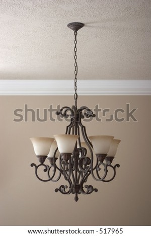 Wrought iron chandelier - stock photo