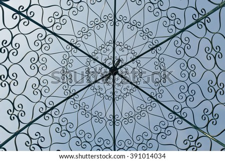 Wrought iron gate and fence - stock photo