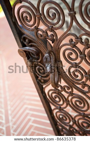 Wrought iron gate at the entrance of a garden