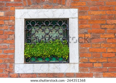 wrought iron window of a typical Venetian house, Italy - stock photo