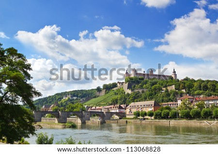 Wuerzburg with view over the Main River towards the Alte Mainbruecke and the Festung Marienberg. - stock photo