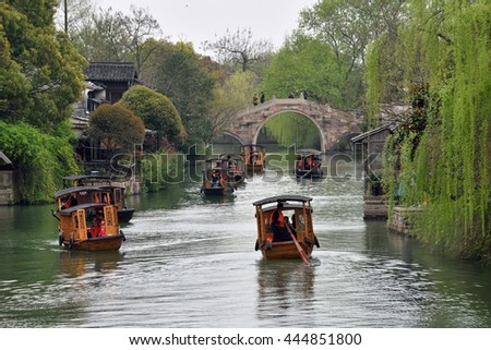 WUZHEN, CHINA - MARCH 24: Traditional Chinese boats on March 24, 2016 in Wuzhen, China. Wuzhen is a historic scenic town, located in northern Zhejiang Province, China - stock photo