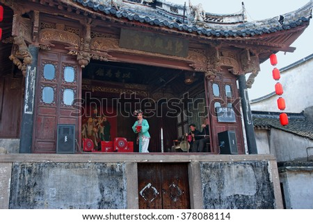 WUZHEN, SHANGHAI-DECEMBER 2, 2008: actress performing in a Chinese theater. Wuzhen water village is Shanghai tourist attraction with more than 100000 visitors per year. - stock photo