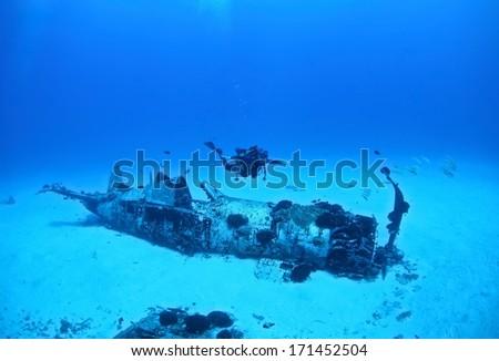 WW2 era Corsair airplane wreck, located in Maunalua Bay, Hawaii  - stock photo