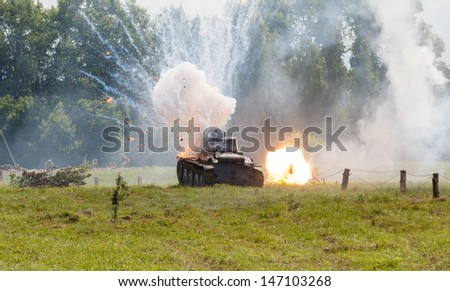 WW2 German Panzer 38 (t) light tank, and the explosion of a shell hit - stock photo