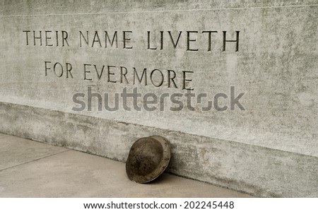 WW1 - Stone Of Remembrance With Helmet - stock photo