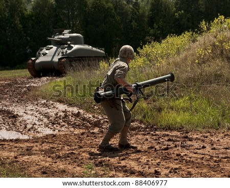 WWII Marine with bazooka stopping Sherman Tank - stock photo