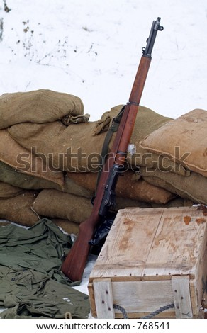 WWII rifle in a winter setting. - stock photo