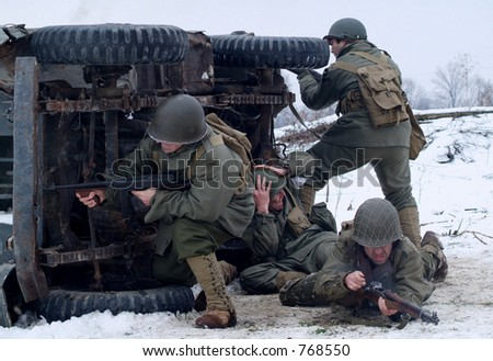 WWII Soldiers in a winter setting. (firing back, from behind a cover of a burning jeep)