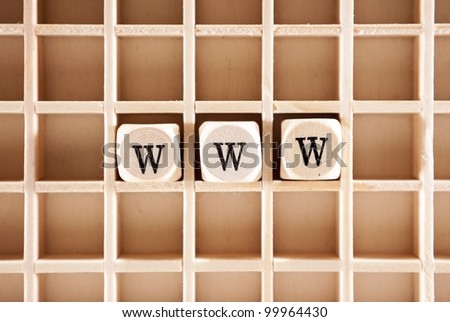 WWW letters construction with letter blocks / cubes and a shallow depth of field - stock photo