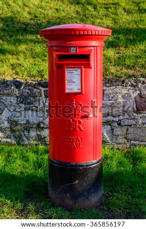 WYMESWOLD, ENGLAND - JANUARY 15: A rural British red traditional Royal Mail pillar box. In Wymeswold, England on 15th January 2016.