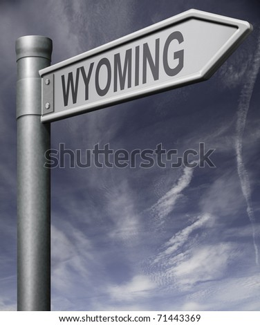 wyoming road sign arrow pointing towards one of the united states of america signpost with clipping path